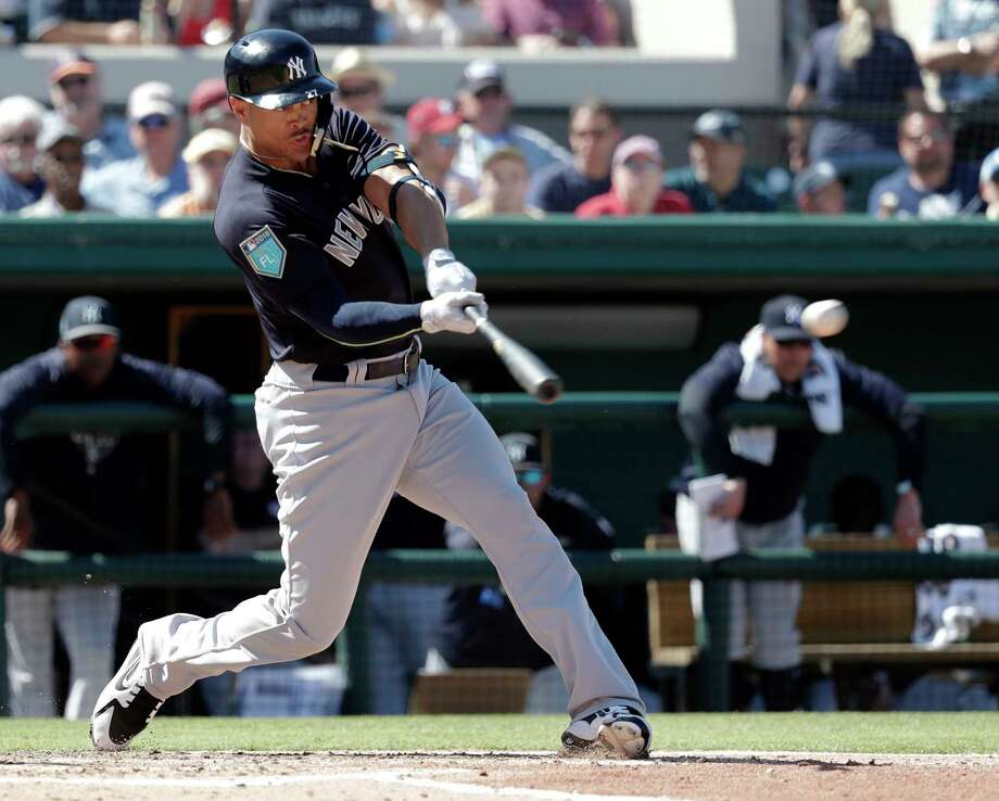New York Yankees' Giancarlo Stanton hits a double in the fourth inning during a spring baseball exhibition game against the Detroit Tigers, Tuesday, March 6, 2018, in Lakeland, Fla. (AP Photo/John Raoux) Photo: John Raoux / Copyright 2018 The Associated Press. All rights reserved.