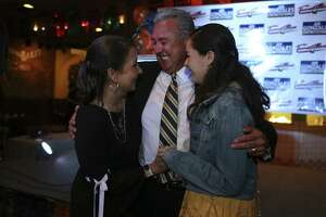 Democratic Bexar County District Attorney candidate Joe Gonzalez celebrates with his wife, Yvonne, left, and daughter, Marissa, 17, after taking a commanding lead in early voting results, Tuesday, March 6, 2018. Gonzalez looks the early voting with 61-percent over incumbent Nico LaHood who came in with 38-percent.