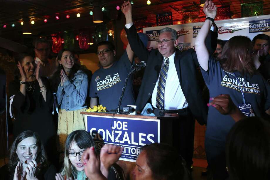 Democratic Bexar County District Attorney candidate Joe Gonzales celebrates his victory with family and friends at Tomatillos Mexican Restaurant, Tuesday, March 6, 2018. Gonzales had a commanding lead over incumbent Nico LaHood. On the left is his daughter, Marissa, 17. Photo: JERRY LARA / San Antonio Express-News / © 2018 San Antonio Express-News