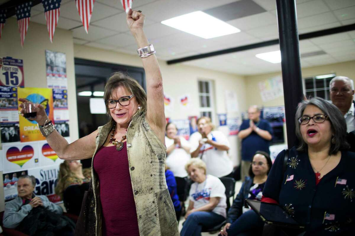 Patti Joiner celebrates the primary election results favoring Sylvia Garcia, Tuesday, March 6, 2018, in Houston.