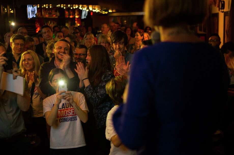 Supporters of 7th District candidate Laura Moser applaud as she addresses the crowd at her primary campaign party at The West End on Westheimer, Tuesday, March 6, 2018, in Houston. Photo: Mark Mulligan, Houston Chronicle / © 2018 Houston Chronicle