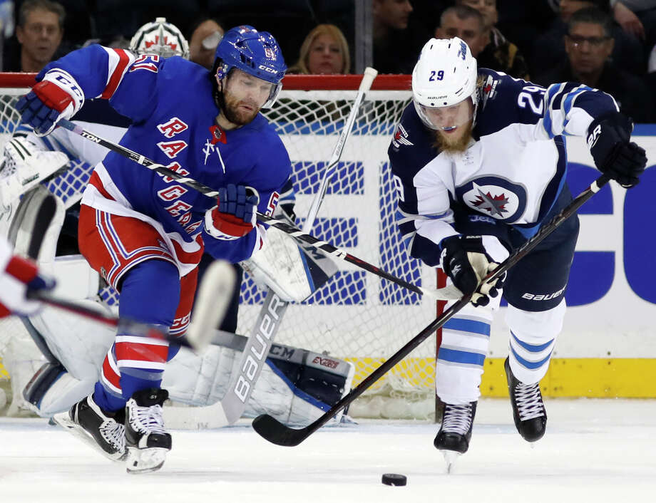 Winnipeg Jets right wing Patrik Laine (29) of Finland keeps the puck from New York Rangers center David Desharnais (51) during the third period of an NHL hockey game in New York, Tuesday, March 6, 2018. (AP Photo/Kathy Willens) Photo: Kathy Willens / Copyright 2018 The Associated Press. All rights reserved.