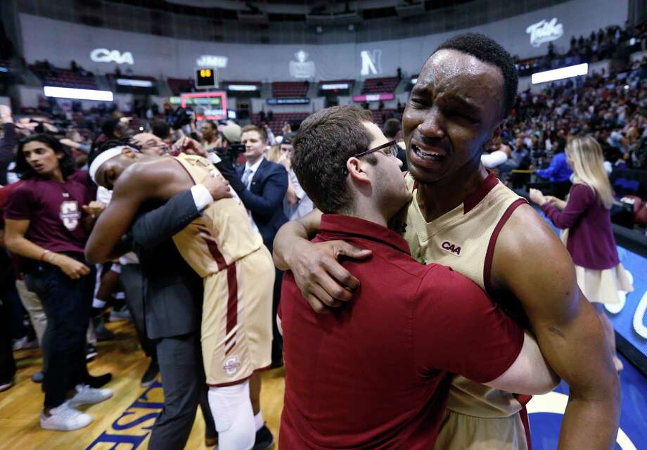College of Charleston's Joe Chealey, at right, shows his emotions after defeating Northeastern in overtime 83-76 of an NCAA college championship basketball game in the Colonial Athletic Association tournament at the North Charleston Coliseum in North Charleston, S.C., Tuesday, March 6, 2018. (AP Photo/Mic Smith) Photo: Mic Smith / Mic Smith Photography LLC