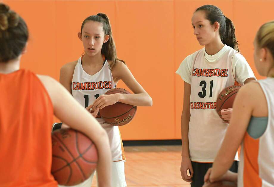 Cambridge twin sisters Lilly, left, and Sophie Phillips listen to their coach during basketball practice on Tuesday, March 6, 2018 in Cambridge, N.Y. The freshman pair are the team's leading scorers. (Lori Van Buren/Times Union) Photo: Lori Van Buren / 20043131A