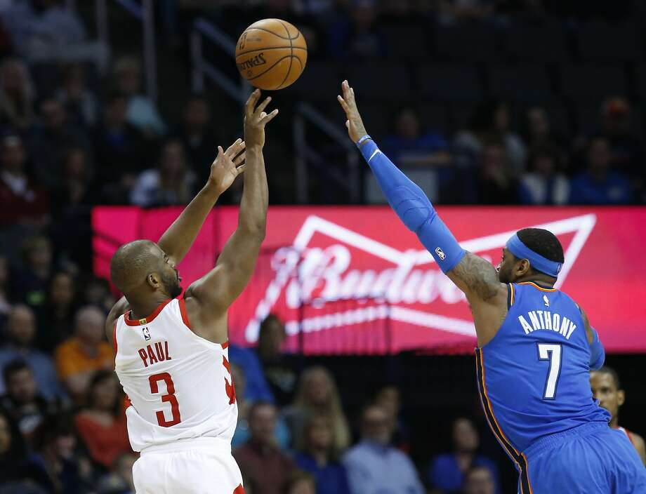 2693378d1aae2f Rockets guard Chris Paul shoots over Thunder forward Carmelo Anthony during  the second half in Oklahoma