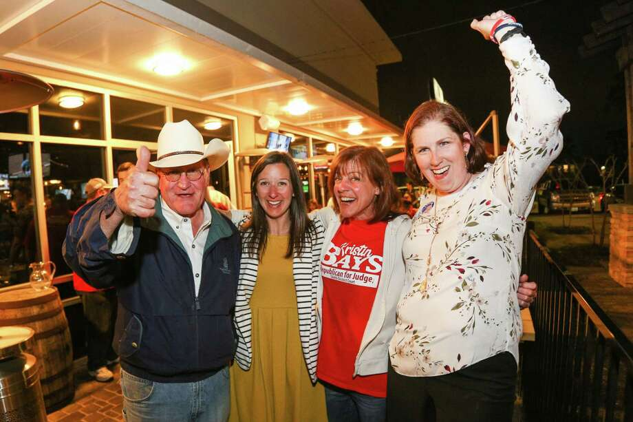 From the left, Mark Keough, Melisa Miller, Kristin Bays and Melanie Bush celebrate together as election results pour in on Tuesday, March 6, 2018, at Woodson's. Photo: Michael Minasi, Staff Photographer / © 2017 Houston Chronicle