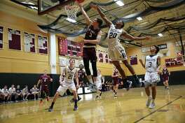 Jackson Ryan of Darien goes up for a layup against Rye Country Day School.