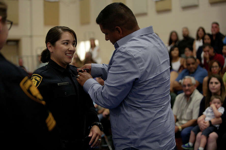 The Seguin Police Department is looking for a few good men and women who are certified peace officers and who want to become part of their team. Jessica Cruz-Villarreal has her badge pinned on by her husband, Johnny Villarreal, during the family day ceremony at the San Antonio Police Training Academy on Aug. 31, 2017. Photo: Lisa Krantz/SAN ANTONIO EXPRESS-NEWS