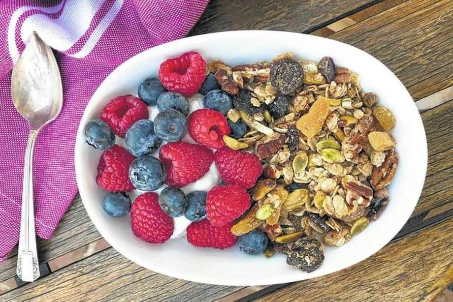 A dish of homemade granola is paired with fresh fruits and yogurt. Photo: Elizabeth Karmel | Associated Press