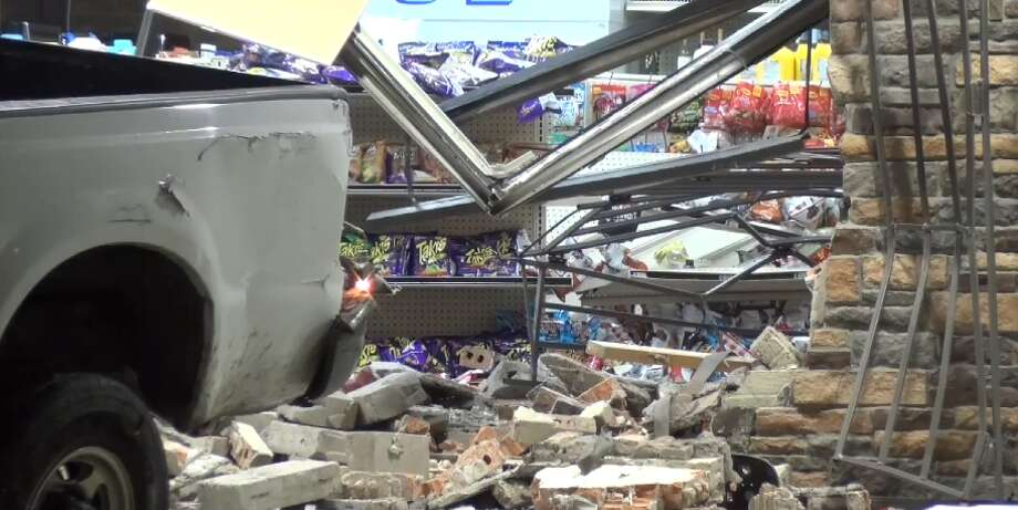A person driving a white truck smashed through a Heights convenience store in an attempted burglar, working at a food truck in west Houston Wednesday, March 7, 2018. Photo: Metro Video