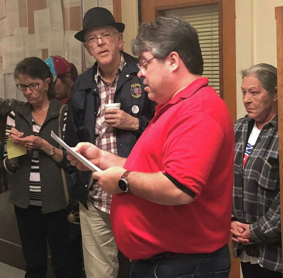 San Jacinto County Republican Party Chairman Dwayne Wright reads off the results of the party's early votes for the primary election on March 6 at the county courthouse. Photo: Jacob McAdams
