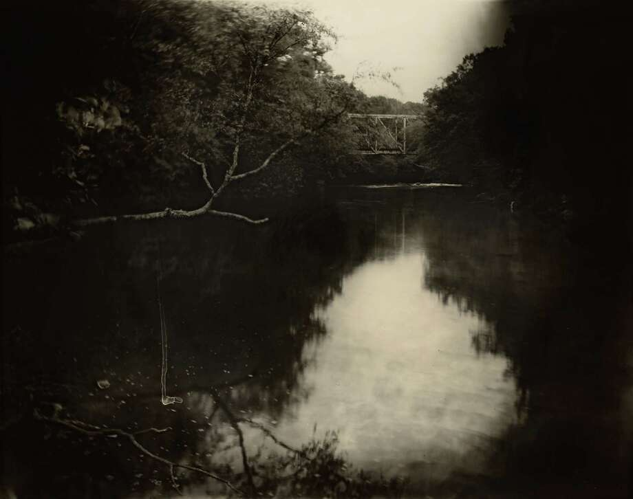 """Sally Mann's 1998 photograph """"Deep South, Untitled (Bridge on Tallahatchie),"""" depicts the river where Emmett Till's corpse was recovered. A new National Gallery of Art exhibition rounds up works that span the photographer's career. Photo: Sally Mann- Markel Corporate Art Collection / © Sally Mann"""