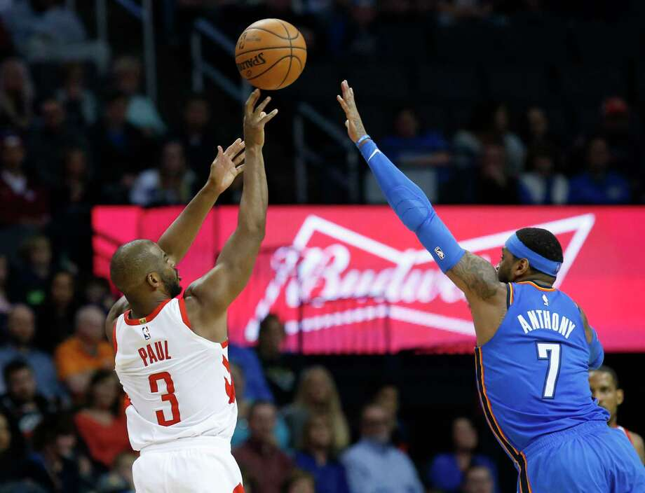 Houston Rockets guard Chris Paul (3) shoots over Oklahoma City Thunder forward Carmelo Anthony (7) in the second half of an NBA basketball game in Oklahoma City, Tuesday, March 6, 2018. (AP Photo/Sue Ogrocki) Photo: Sue Ogrocki, Associated Press / AP2018
