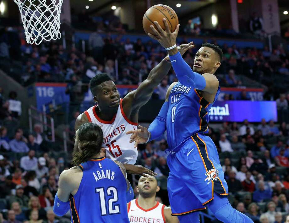 Oklahoma City Thunder guard Russell Westbrook (0) shoots in front of Houston Rockets center Clint Capela, center, and teammate Steven Adams (12) in the second half of an NBA basketball game in Oklahoma City, Tuesday, March 6, 2018. (AP Photo/Sue Ogrocki) Photo: Sue Ogrocki, Associated Press / AP2018