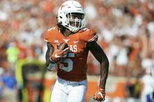Holton HIll looks back at the field he left behind for a pick six in the second half as Texas hosts San Jose State at DKR Stadium on September 9, 2017.