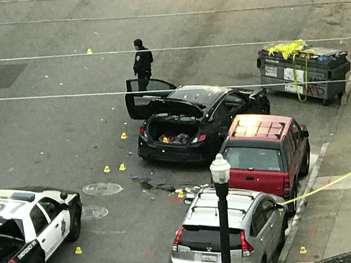 Dozens of evidence markers; shell casings visible in this overhead view of San Francisco Police Officer-involved shooting by KTVU's Allie Rasmus. Police say shooting occurred while they tried to detain robbery suspect hiding in trunk of a car on 22nd and Capp Streets in San Francisco.