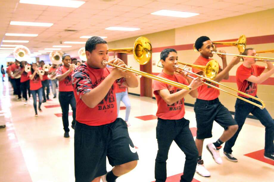 Port Arthur Memorial High School students, faculty and staff lined the halls Wednesday morning as the Titans boys basketball team followed the pep band and Flames while marching to the school bus before leaving campus and heading to the UIL state tournament in San Antonio. (Mike Tobias/The Enterprise) Photo: Mike Tobias/The Enterprise