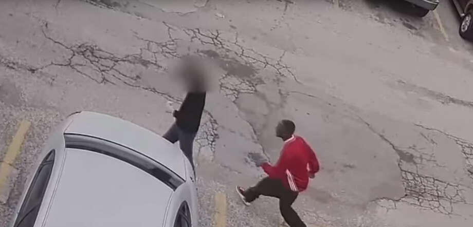 The Houston Police Department is searching for two men who were caught on video robbing another of his cell phone in early February on Houston's west side. Photo: Houston Police Department