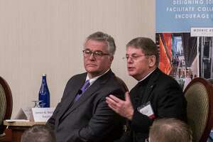 Fr. F. Edward Coughlin. O.F.M. Ph.D., president of Siena College, right,  speaks as college presidents from the Capital Region gathered at the Hilton Garden Inn on Wednesday, March 7, 2018, in Troy, N.Y., for a panel discussion on various subjects pertaining to higher education. The presidents that joined the panel are Andrew Matonak, Hudson Valley Community College;   Havidán Rodríguez  , University at Albany;  Carolyn J. Stefanco, College of Saint Rose, James N. Baldwin, Excelsior College and Fr. F. Edward Couglin, Siena College.   (Skip Dickstein/Times Union)
