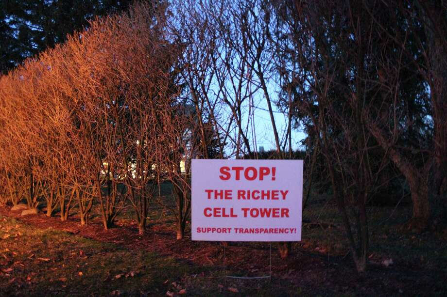 Signs like this have sprung up on Soundview Lane in opposition to Keith Richey's plans for a potential cell tower. Picture taken March 5, 2018. Photo: Humberto J. Rocha / Hearst Connecticut Media / New Canaan News
