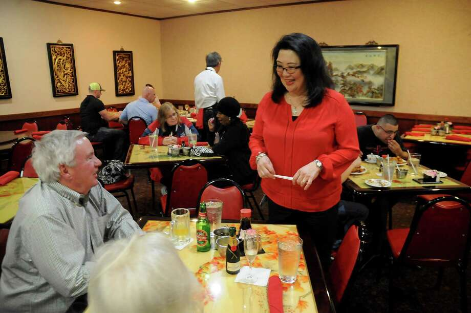 Carol Jue Churchill talks with customers at China Garden Restaurant on Leeland St. downtown Saturday March 03,2018. (Dave Rossman Photo) Photo: Dave Rossman, Freelance / Dave Rossman