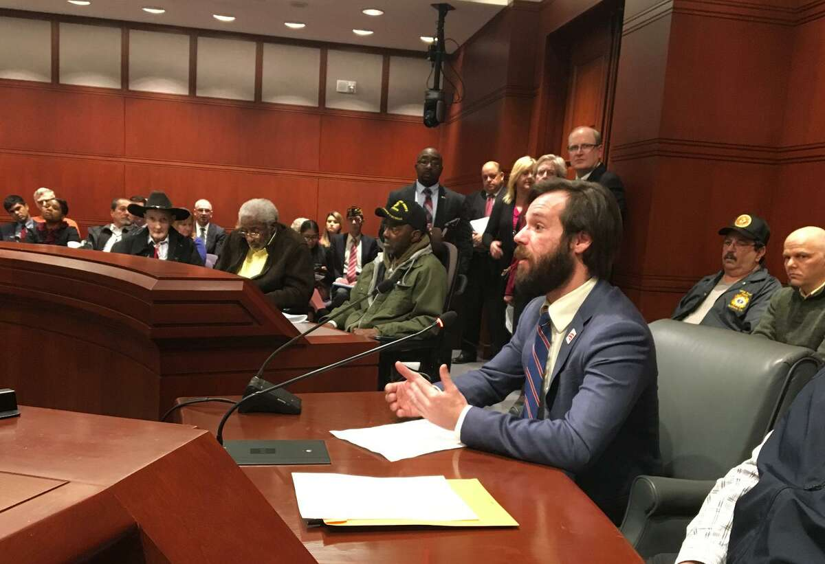 Thomas Burke, a Marine Corp's veteran who received a less-than-honorable discharge, appears before the Veterans Affairs Committee of the General Assembly on Tuesday, March 6, 2018 at the State Capitol in Hartford, Conn. Burke asked state lawmakers to allow those whose with mental-health issues to gain some benefits from which they are currently prohibited.