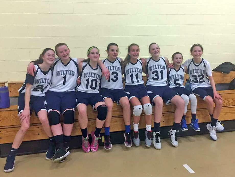 The Wilton Youth Basketball Girls 7th Grade team poses for a photo after a tournament game last weekend. Photo: Contribued Photo