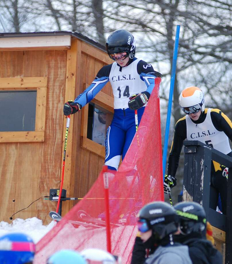 Ryan van Heyst, a freshman on the Wilton High ski team, gets ready to burst from the gate. Photo: Contributed Photo /Hearst Media Connecticut /