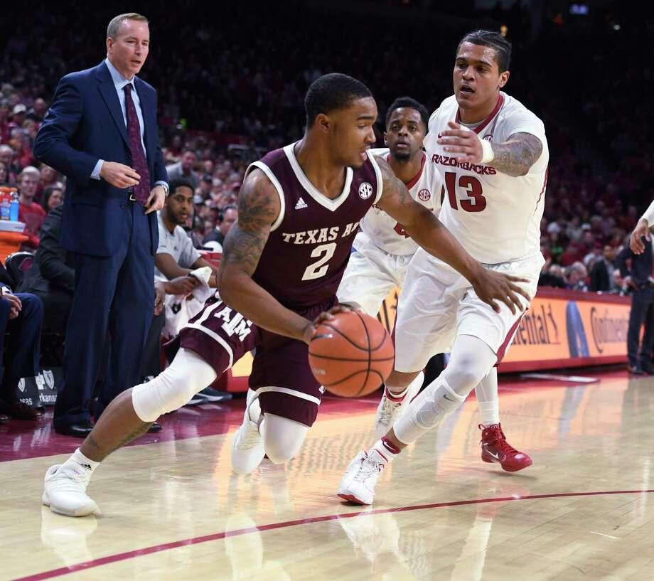 Texas A&M guard TJ Starks tries to get past Arkansas defender Dustin Thomas during the first half of an NCAA college basketball game Saturday, Feb. 17, 2018, in Fayetteville, Ark. (AP Photo/Michael Woods) Photo: Michael Woods, Associated Press / Associated Press