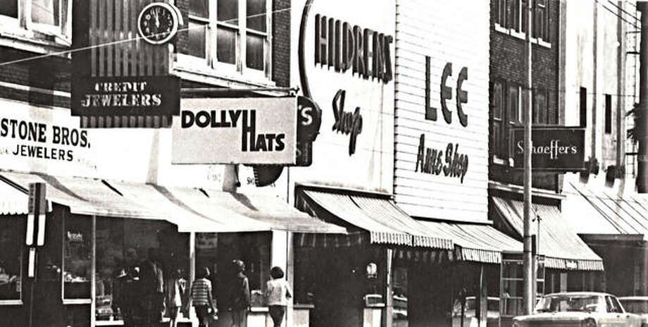 West Third Street in Downtown Alton as it was in 1969. Locals will recognize many staples, including Dolly Hats, Children's Shop, and Stone Bros. Credit Jewelers, the sign for which still hangs today. Just out of frame is Luken Insurance, another mainstay. Photo: File Photo