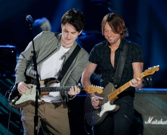 John Mayer, left, and Keith Urban perform at the 2010 CMT Awards in Nashville, Tenn. Wednesday, June 9, 2010.  (AP Photo/M. Spencer Green) Photo: M. Spencer Green