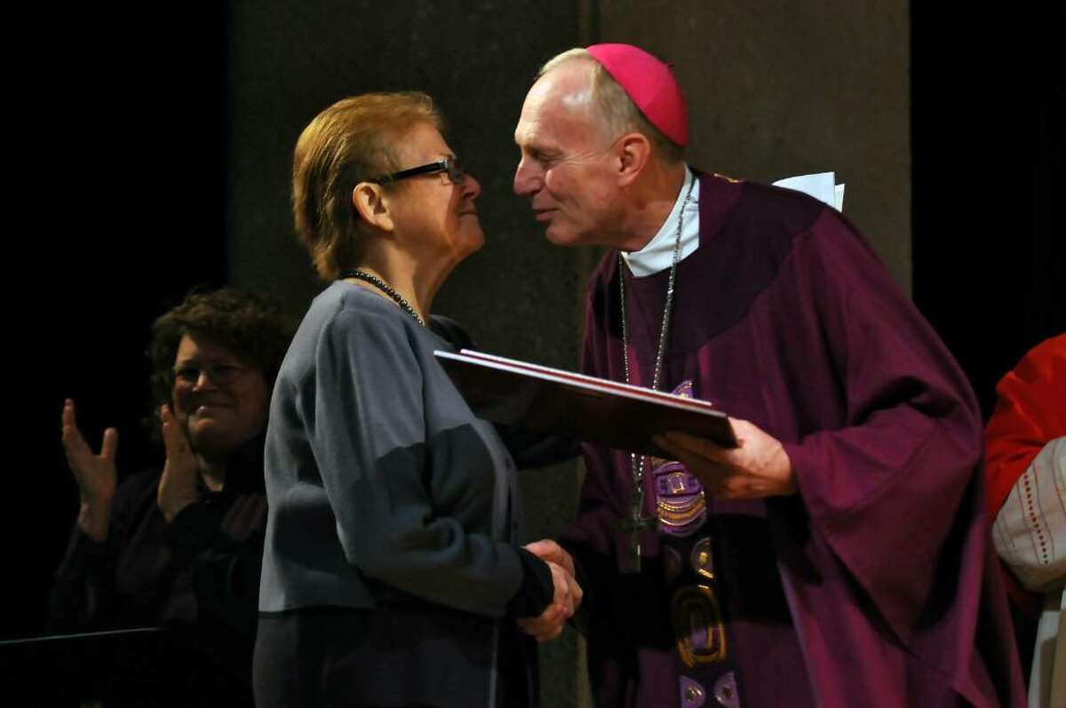 Bishop Howard Hubbard gives Sister Maureen Joyce, executive director of Catholic Charities of the Diocese of Albany, the J. Alan Davitt Award for Exemplary Service during an awards presentation at the Empire State Plaza Convention Center in Albany on Tuesday, March 9, 2010. Joyce dide Friday at 66 of cancer. (Philip Kamrass / Times Union)
