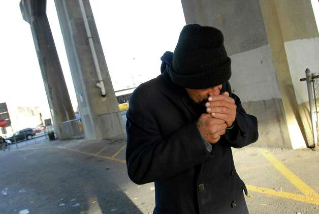 "Samuel ""Poppy"" Baez finds a partially-smoked cigarette and stops to light it up as he walks on Wednesday, Oct. 14, 2009, under a Highway 787 bridge in Albany, N.Y. (Cindy Schultz / Times Union) Photo: CINDY SCHULTZ"