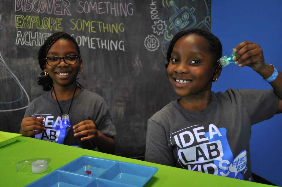 Korede and Kolade are all smiles after creating lights at Idea Lab Kids. Photo: Courtesy Photo