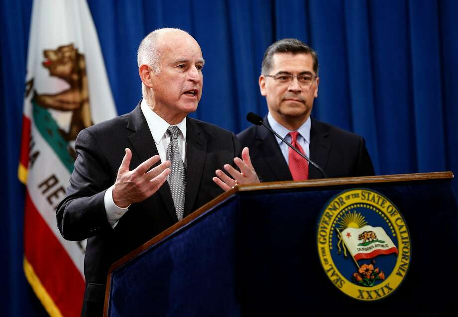 California Governor Edmund G. Brown Jr. (left) joins Attorney General Xavier Becerra at a press conference at the State Capitol in Sacramento, Calif. on Wed. March 7, 2018, to discuss U.S. Attorney General Jeff Sessions� decision to sue the State of California. Photo: Michael Macor, The Chronicle