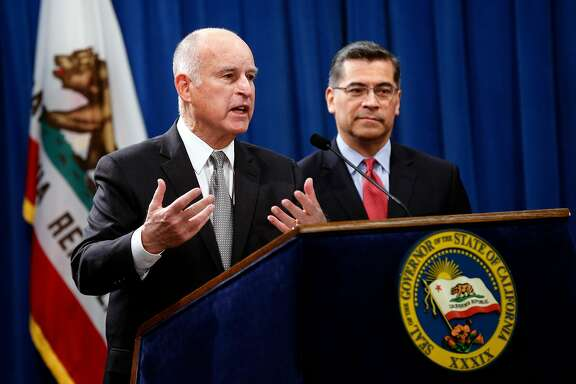 California Governor Edmund G. Brown Jr. (left) joins Attorney General Xavier Becerra at a press conference at the State Capitol in Sacramento, Calif. on Wed. March 7, 2018, to discuss U.S. Attorney General Jeff Sessions� decision to sue the State of California.