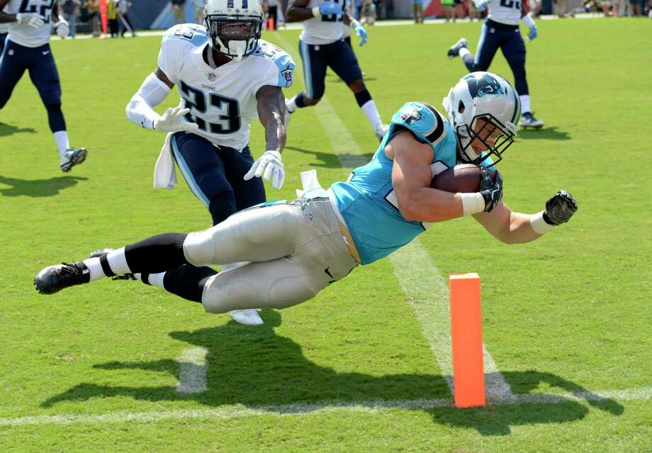 File- This Aug. 19, 2017, file photo shows Carolina Panthers running back Christian McCaffrey diving into the end zone for a touchdown on a 17-year run ahead of Tennessee Titans cornerback Brice McCain (23) in the first half of an NFL football preseason game in Nashville, Tenn. While backup running back McCaffrey has been stellar in the preseason showing big- play capability, the Panthers struggled early on in a 34-27 preseason loss to the Tennessee Titans on Saturday. Photo: Mark Zaleski, AP / ONLINE_YES