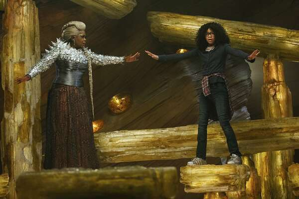"This image released by Disney shows Oprah Winfrey, left, and Storm Reid in a scene from ""A Wrinkle In Time."" (Atsushi Nishijima/Disney via AP)"