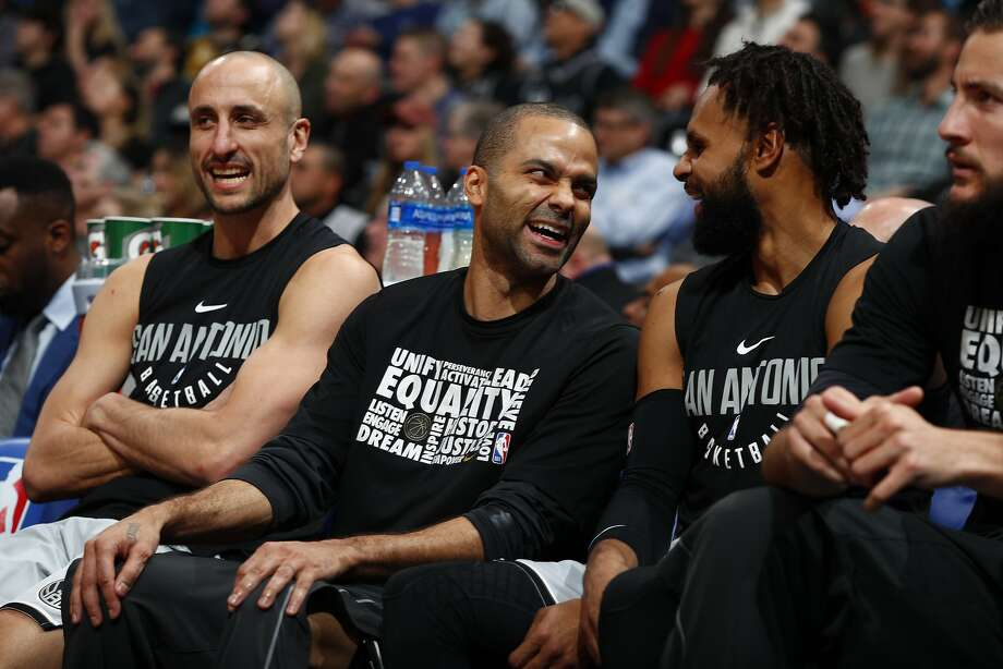 From left, San Antonio Spurs guard Manu Ginobili (20), San Antonio Spurs guard Tony Parker (9) and San Antonio Spurs guard Patty Mills (8) in the first half of an NBA basketball game Tuesday, Feb. 13, 2018, in Denver. (AP Photo/David Zalubowski) Photo: David Zalubowski, Associated Press