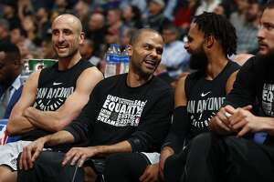 From left, San Antonio Spurs guard Manu Ginobili (20), San Antonio Spurs guard Tony Parker (9) and San Antonio Spurs guard Patty Mills (8) in the first half of an NBA basketball game Tuesday, Feb. 13, 2018, in Denver. (AP Photo/David Zalubowski)