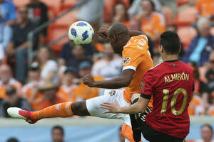 Houston Dynamo defender Adolfo Machado (3) and Atlanta United midfielder Miguel Almiron (10) battle for control of the ball during the first half of the MLS game at BBVA Compass Stadium on Saturday, March 3, 2018, in Houston. ( Yi-Chin Lee / Houston Chronicle )