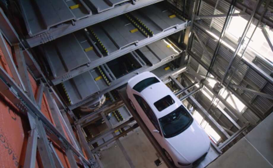 A car being lifted to its parking spot inside the Hive. Photo: CityLift Parking