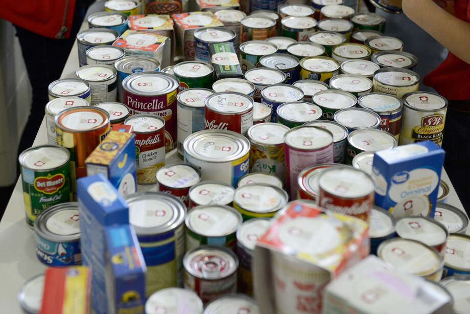 The youth at First Presbyterian Church are collecting canned goods, monetary donations, toilet paper and soap for Faith In Sharing House (FISH) Photo: Duane Prokop / Getty Images