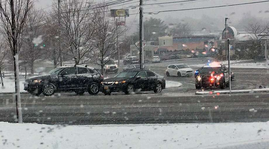 Norwalk police are investigating a two-car motor vehicle crash on Scribner Avenue in Norwalk, Conn., during the snowstorm on March 7, 2018. There did not appear to be any injuries. Based on a photo of the crash provided by police, the crash seemed minor. Photo: Contributed Photo / Norwalk Police Department / Contributed Photo / Connecticut Post Contributed