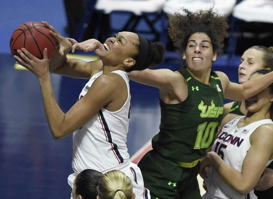 UConn's Azura Stevens is fouled by South Florida's Laura Ferreira during the second half Tuesday in Uncasville. Stevens was named the AAC tournament's Most Outstanding Player. Photo: Jessica Hill / Associated Press / AP2018