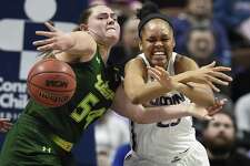 South Florida's Alyssa Rader, left, swats away a pass intended for Connecticut's Azurá Stevens, right, during the second half of an NCAA college basketball game in the American Athletic Conference tournament finals at Mohegan Sun Arena, Tuesday, March 6, 2018, in Uncasville, Conn. (AP Photo/Jessica Hill)