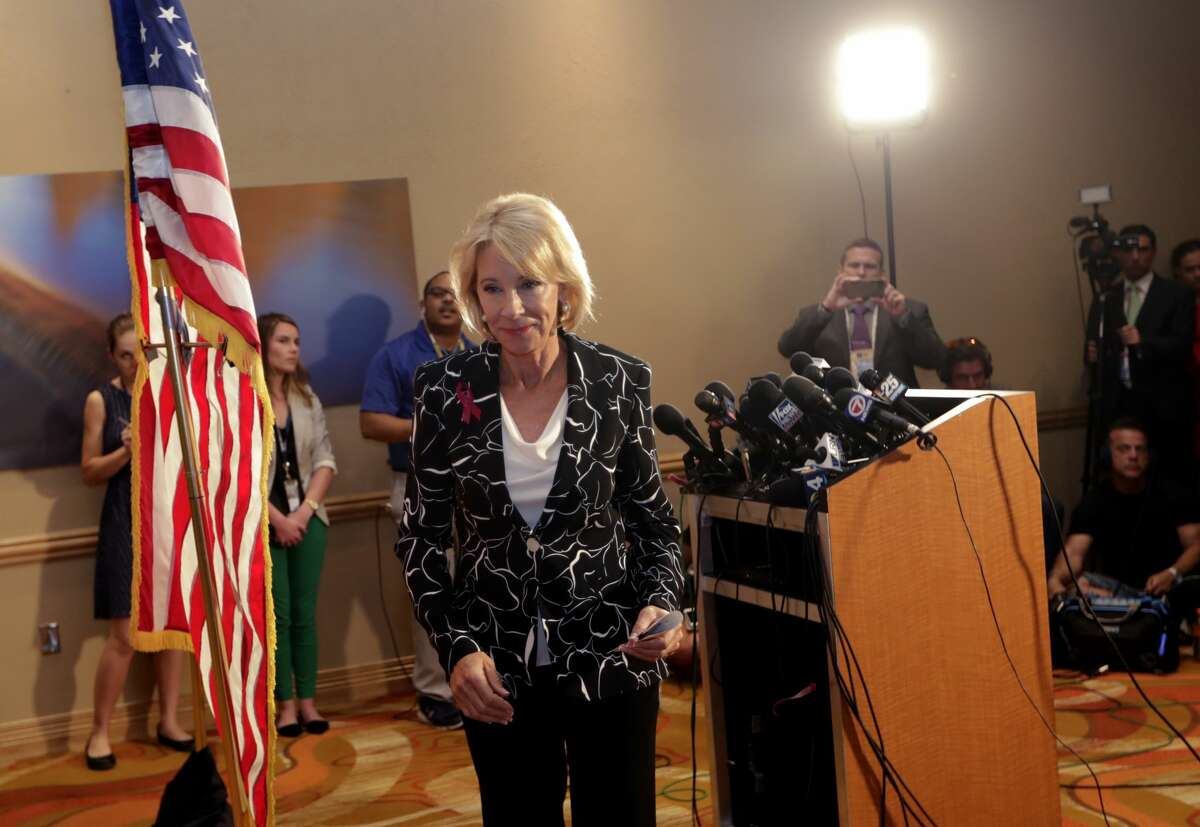 Secretary of Education Betsy DeVos speaks at a news conference following a visit to Marjory Stoneman Douglas High School in the aftermath of a Feb. 14 mass shooting at the school, Wednesday, March 7, 2018, in Coral Springs, Fla. (AP Photo/Lynne Sladky)