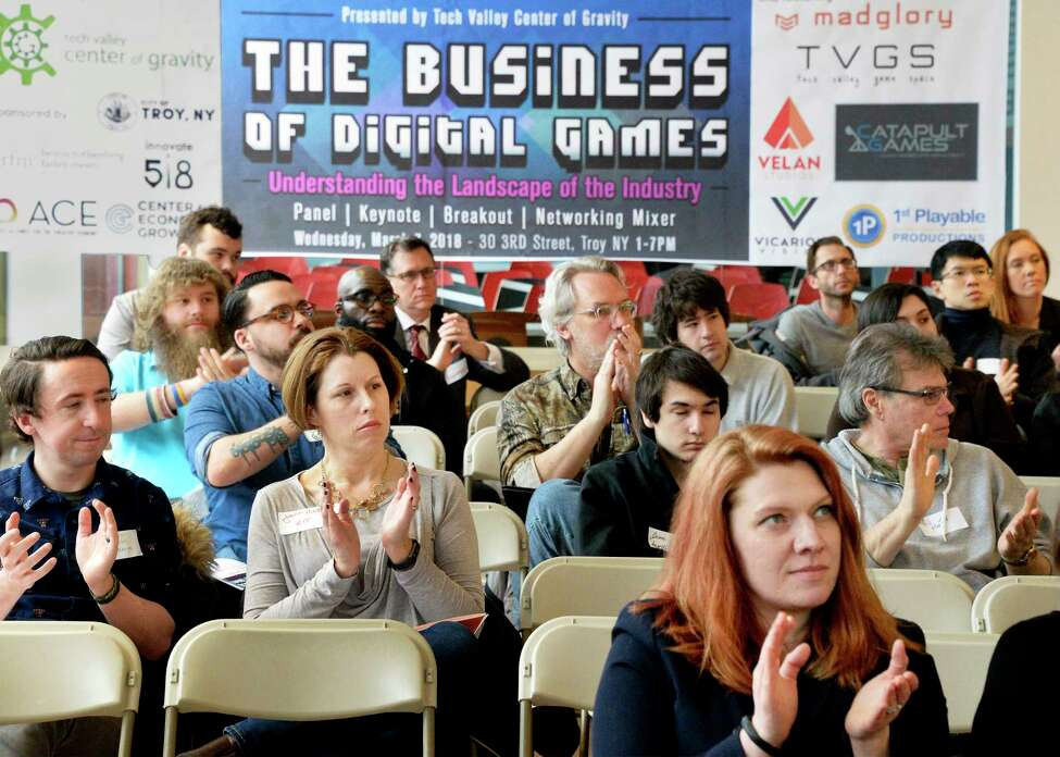 The Business of Digital Games attendees applaud Andrew Kennedy, president and CEO of Center for Economic Growth as he presents the findings of a first-of-its-kind survey of the Capital Region's video game development cluster at the Tech Valley Center of Gravity Wednesday March 7, 2018 in Troy, NY. (John Carl D'Annibale/Times Union)
