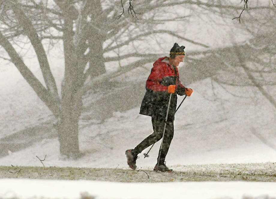 Chris Dunne of Albany runs in Lincoln Park during a snowstorm on Wednesday, March 7, 2018 in Albany, N.Y. (Lori Van Buren/Times Union) Photo: Lori Van Buren, Albany Times Union / 20043148A