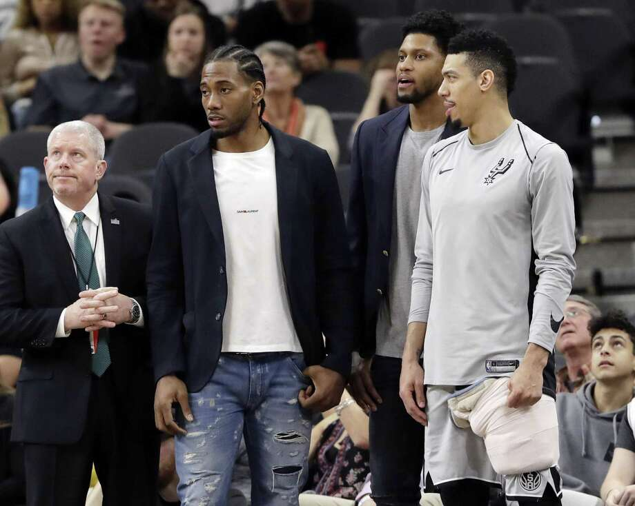 FILE - In this Jan. 21, 2018, file photo, San Antonio Spurs guard Danny Green, right, stands at the bench with injured teammates Kawhi Leonard, second from left, and Rudy Gay, center, during the second half of an NBA basketball game against the Indiana Pacers in San Antonio. Leonard plans on returning this season and wants to remain with the Spurs for life, refuting reports of dissension with the star forward and the only franchise he has played for. Leonard has missed all but nine games this season with right quadriceps tendinopathy, which initially flared up late in the offseason.  (AP Photo/Eric Gay, File) Photo: Eric Gay, STF / Associated Press / Copyright 2018 The Associated Press. All rights reserved.